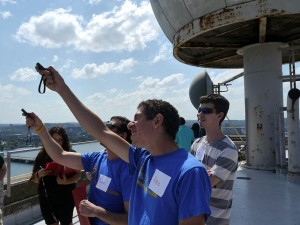 Students take atmospheric measurements on the roof of the Green Building. Credit: Min Ding